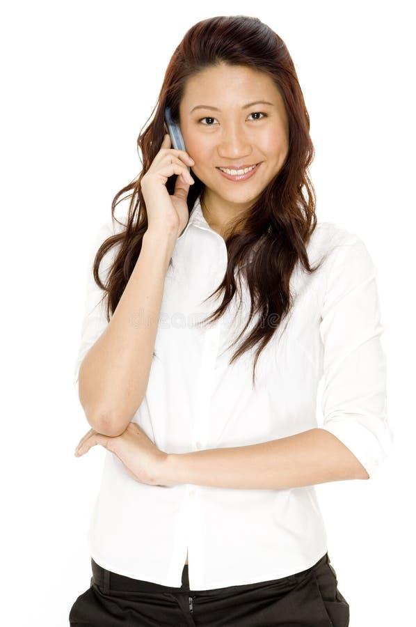 Na Telefonie azjatycka Kobieta zdjęcie stock