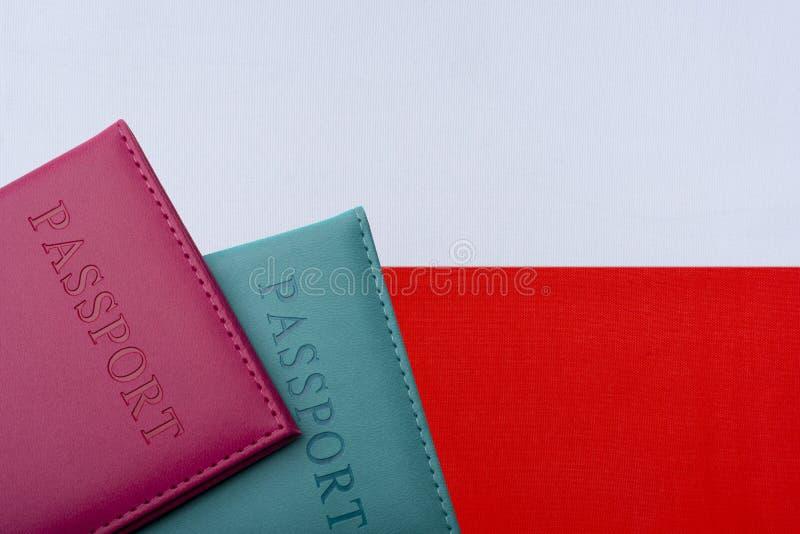 Na tle flaga Polska dwa paszporta zdjęcia royalty free
