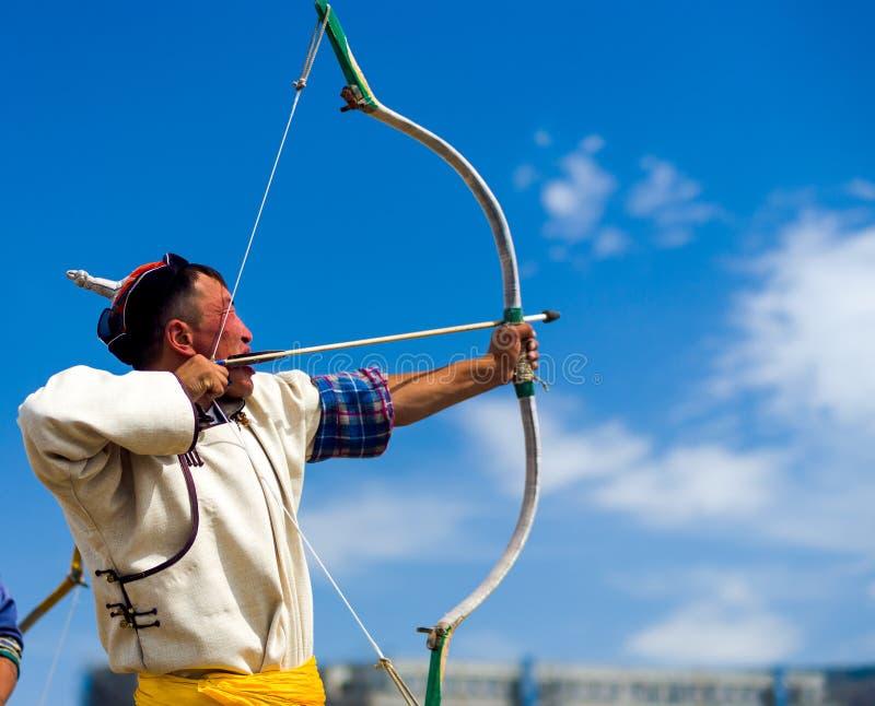 Naadam Festival Archery Man Pulling Bowstring Aim royalty free stock photography