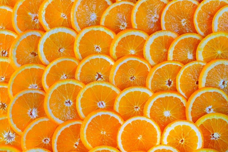 Naadloze abstracte achtergrond van gesneden sinaasappelen royalty-vrije stock afbeelding