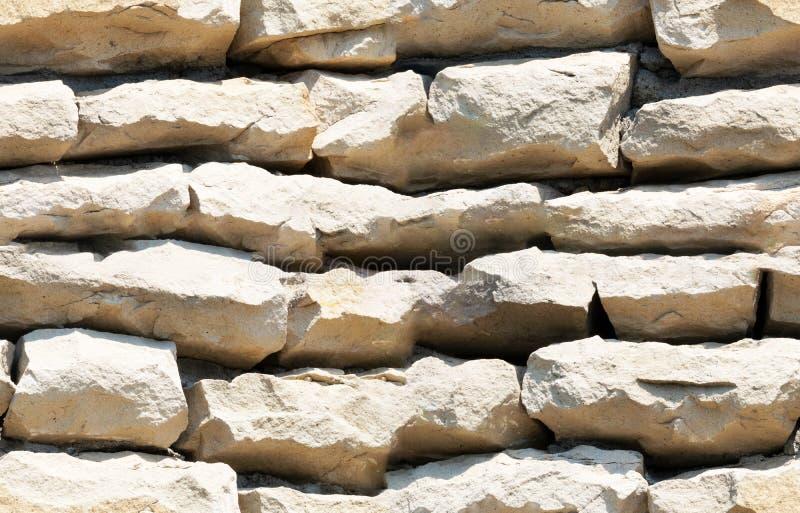 Naadloze die textuur, achtergrond, steen met granietmuren wordt gevoerd zandsteen steen achtergrondmuur Het onder ogen zien van S stock afbeelding