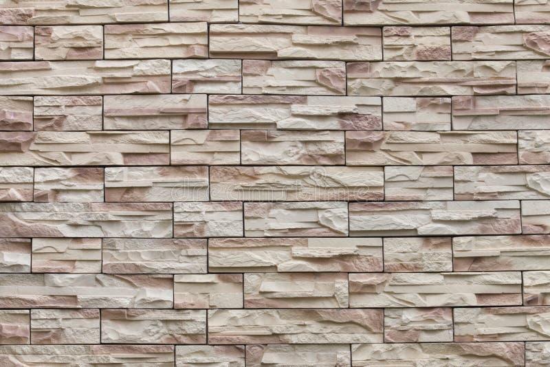 Naadloze textuursteen als achtergrond die met het zand van granietmuren wordt gevoerd stock afbeeldingen