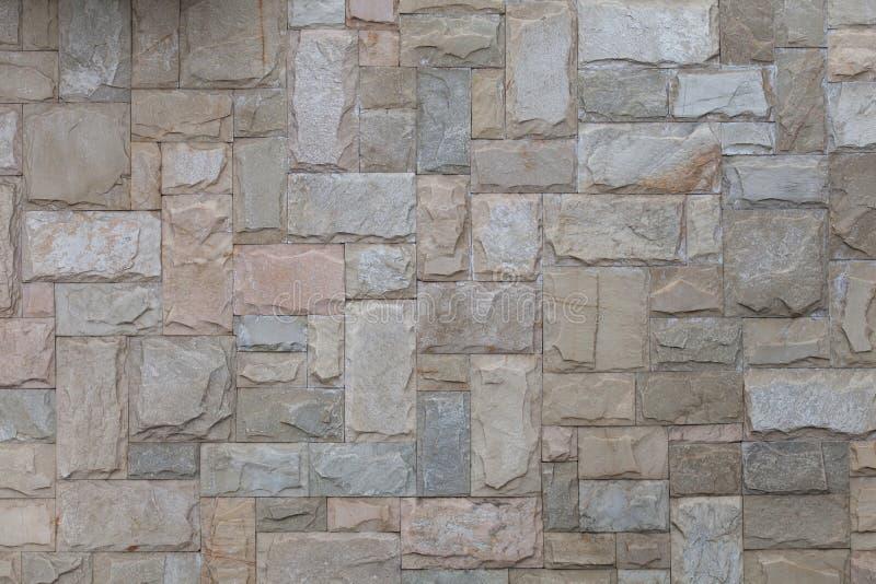 Naadloze textuursteen als achtergrond die met het zand van granietmuren wordt gevoerd stock foto's
