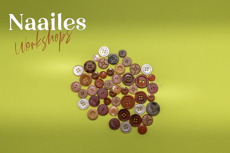 Naailes, Dutch word for sewing lessons with a pile of red buttons . royalty free stock image