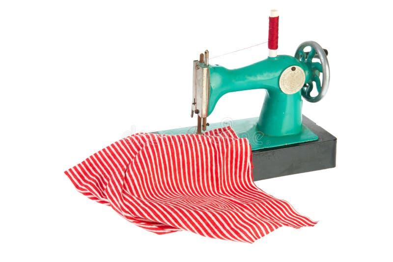 Naaimachine met kleren royalty-vrije stock afbeeldingen