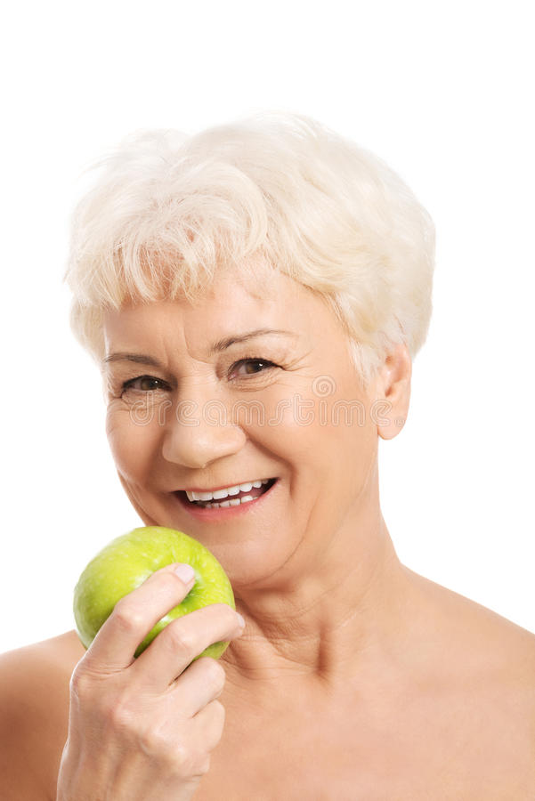 Naakte oude vrouwenholding en appel. stock afbeeldingen