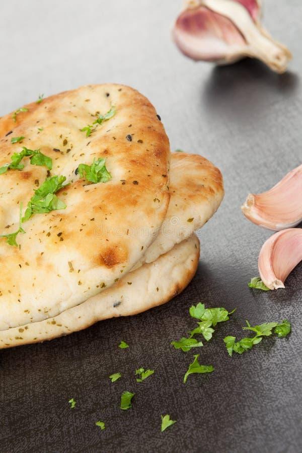 可口naan小面包干背景。 图库摄影