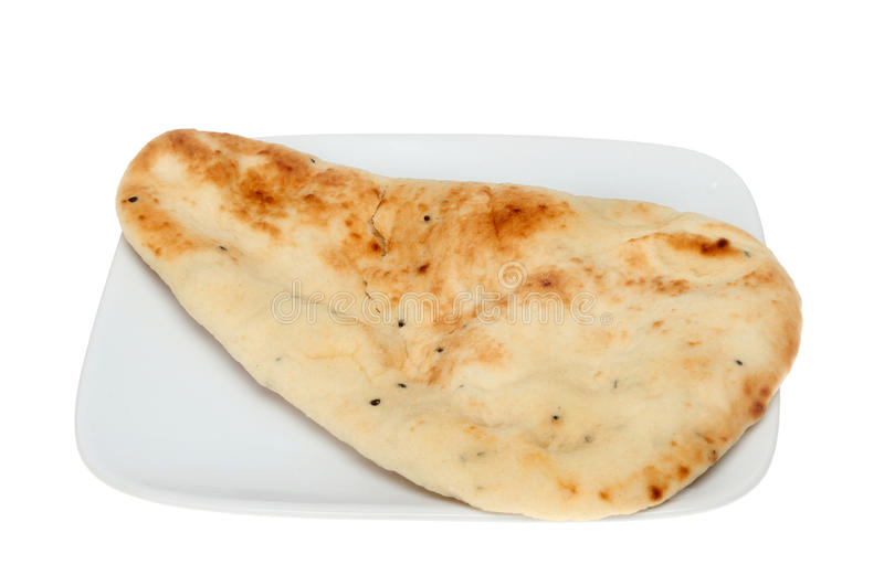 Naan bread. On a plate isolated against white royalty free stock photos