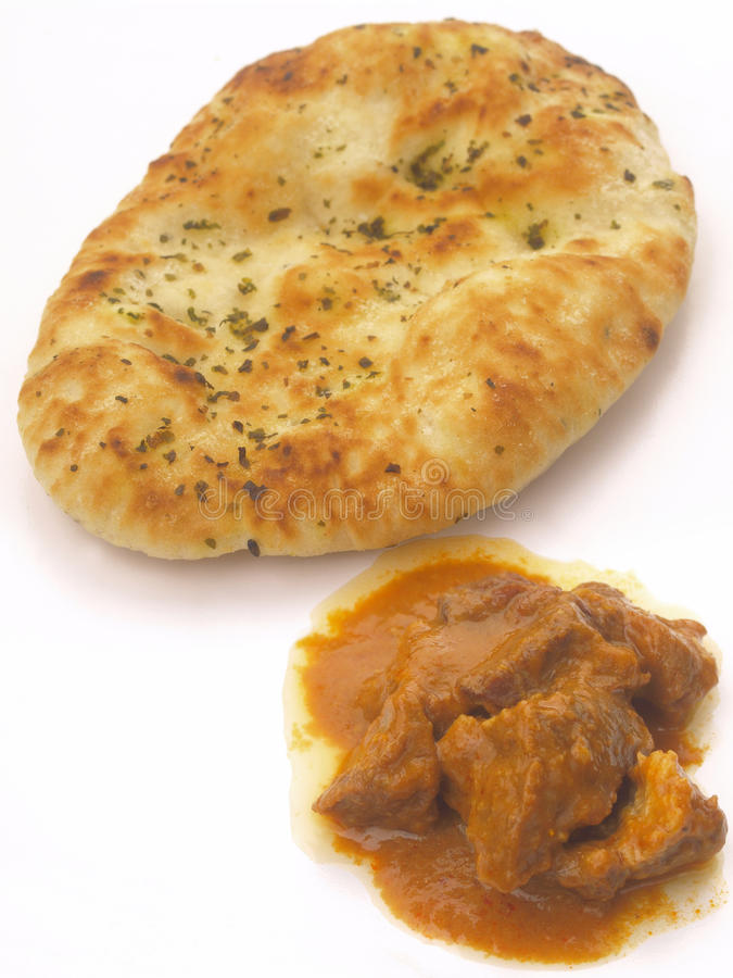 Naan bread with curry. Delicious indian naan bread with curry stock photos