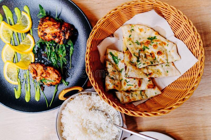 Naan bread tandoori chicken and rice Indian food cuisine royalty free stock photos