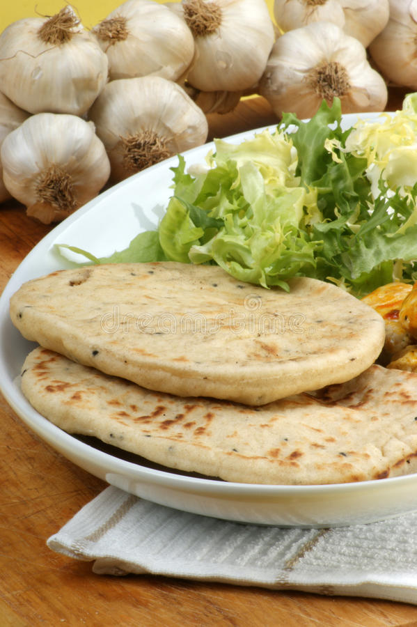 Naan bread with turkey curry stock images