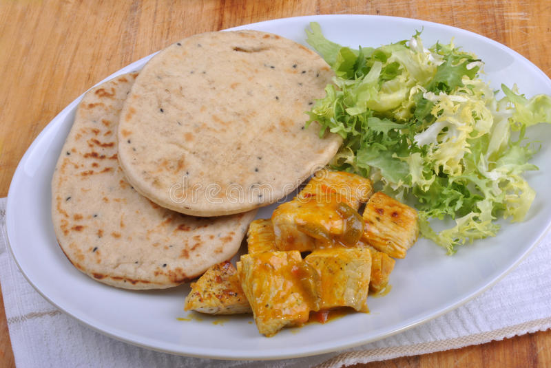 Naan bread with turkey curry stock photo