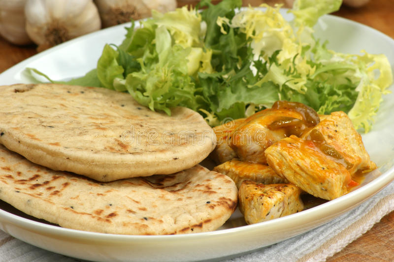 Naan bread with turkey curry royalty free stock image