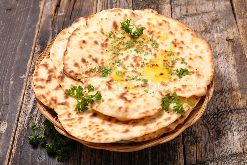 Naan bread. On wood background royalty free stock photos