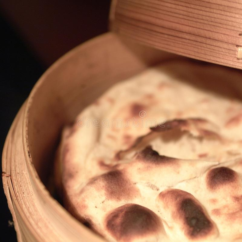 Naan bread in a wood basket stock photo