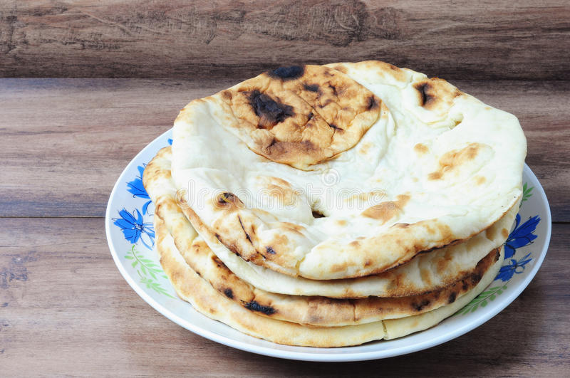 Naan roti flatbread. Nepalese/Indian Naan Flatbread made with Whole Wheat, a plain Indian roti also know as plain tandoori roti stock photo