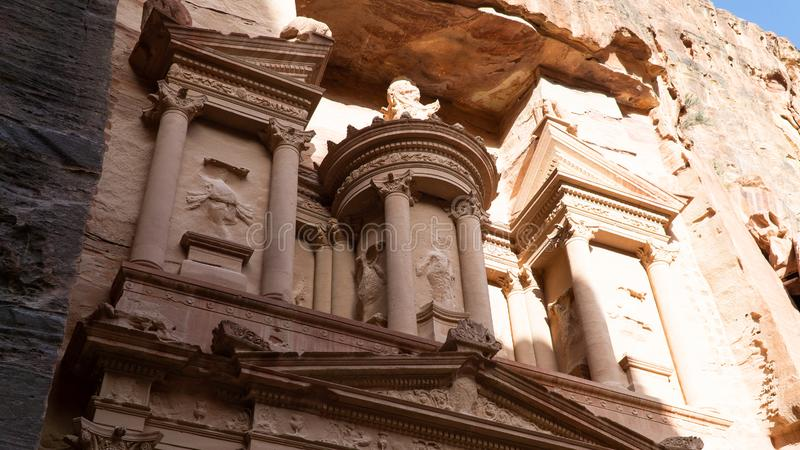 The Nabatean mausoleum Al-Khazneh or The Treasure located in heart of Prehistoric Rock Carved City of Petra, Wonder of The World,. Close up to details, located royalty free stock photography
