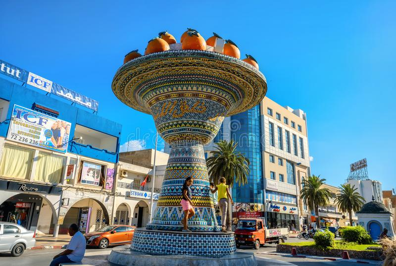Ceramic sculpture in city centre district of Nabeul. Tunisia, No. NABEUL, TUNISIA - JULY 02, 2017: Cityscape with ceramic sculpture on road in city centre. North royalty free stock image