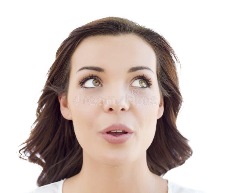 Nachdenkliche junge erwachsene Frau, die oben auf Weiß schaut lizenzfreies stockbild