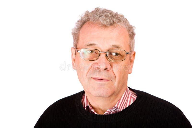 Nachdenklicher älterer Mann stockfotografie
