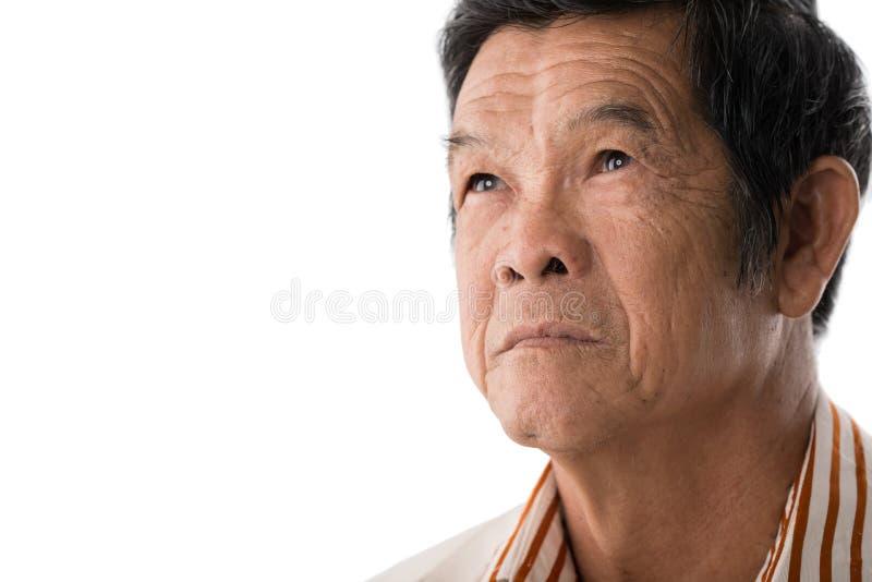 Nachdenklicher älterer Mann stockbild