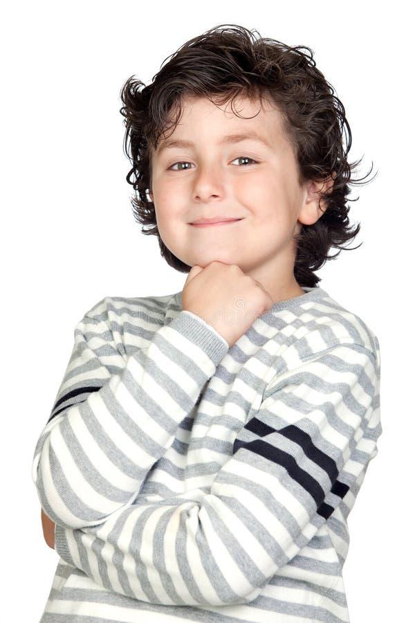 Nachdenkliches Kind mit gestreifter Strickjacke lizenzfreie stockbilder