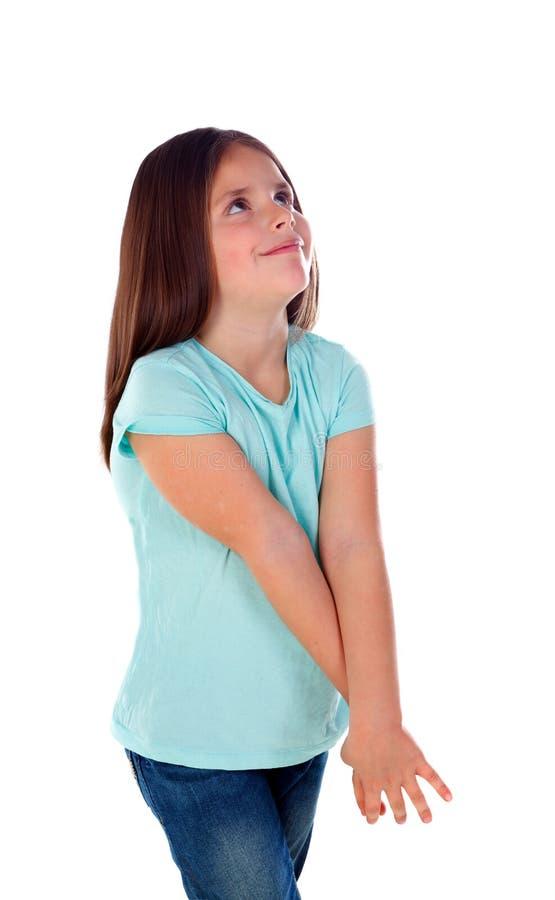 Nachdenkliches kleines Mädchen, das etwas sich vorstellt lizenzfreies stockbild