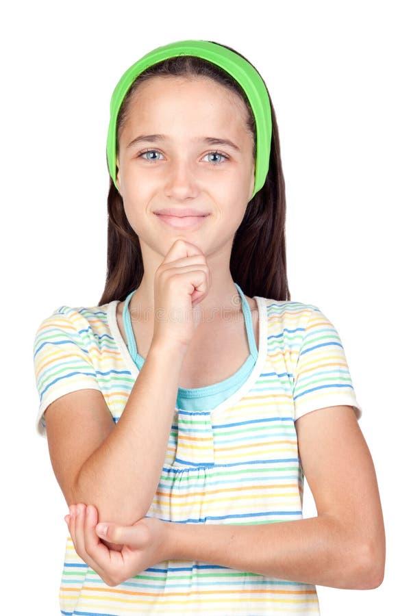 Nachdenkliches kleines Mädchen mit blauen Augen lizenzfreies stockbild