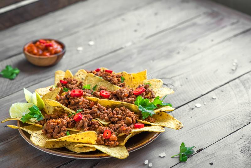 Nachos chips and ground beef stock image