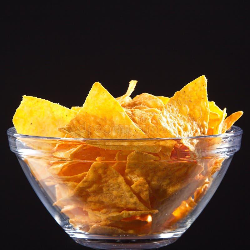 Nachos. Fresh Nachos in glass bowl royalty free stock image