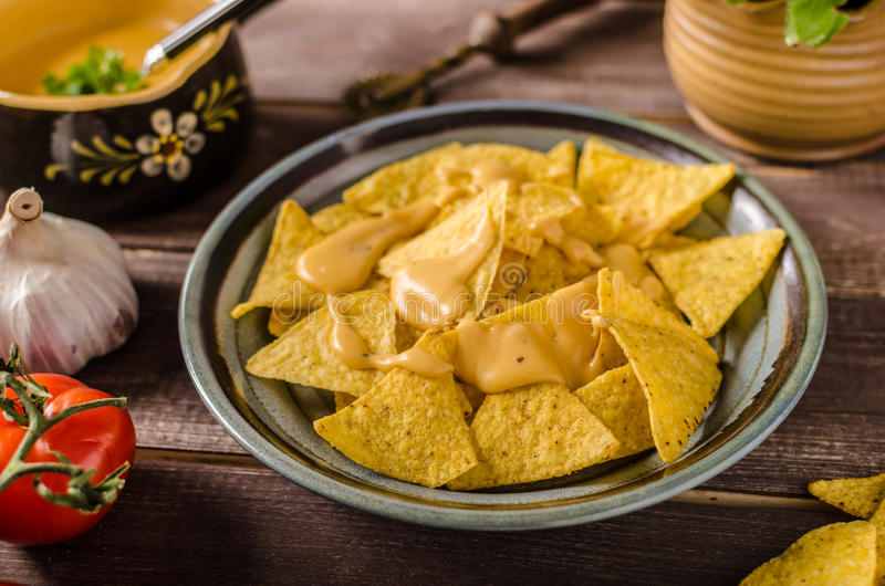 Nachos with homemade cheese dip stock photo