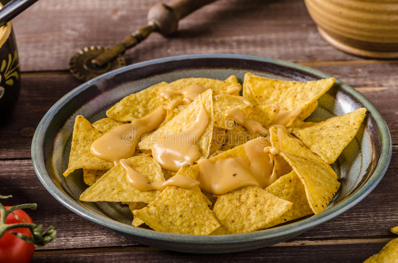 Nachos with homemade cheese dip stock image