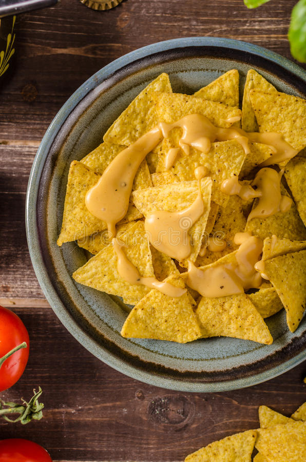 Nachos with homemade cheese dip royalty free stock images