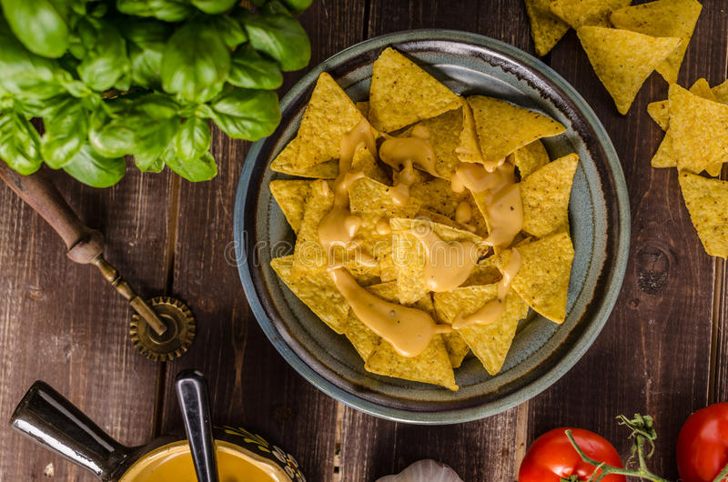 Nachos with homemade cheese dip royalty free stock image
