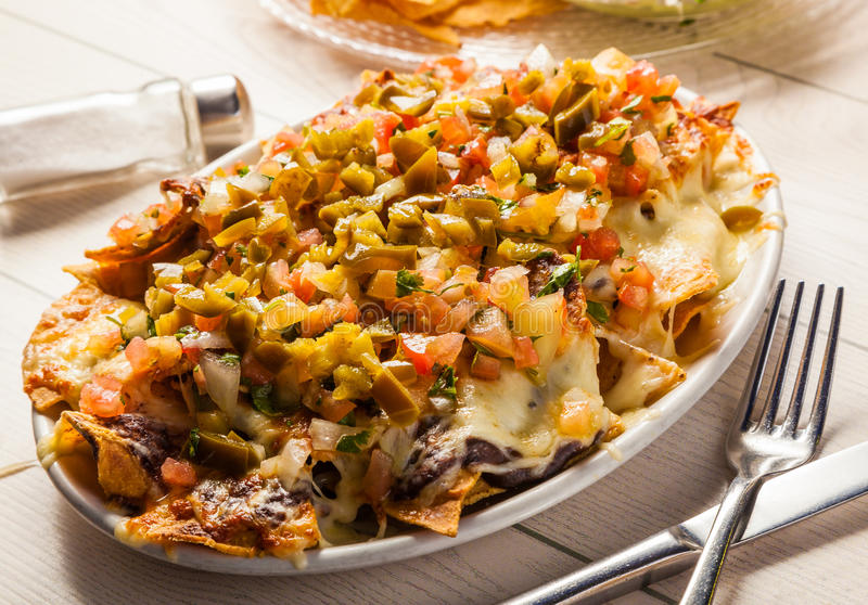 Nachos with melted cheese stock image