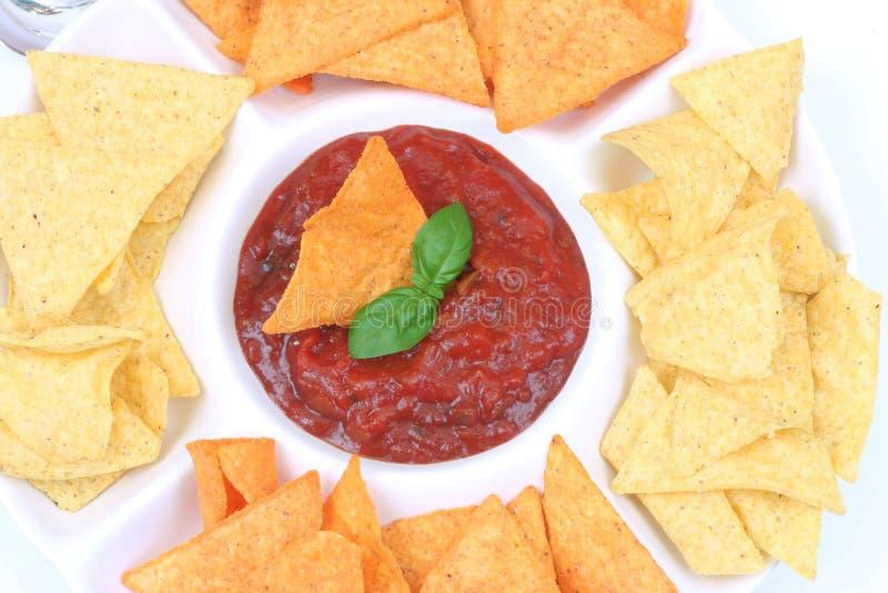 Nachos and salsa dip stock photos