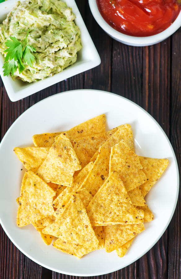 Nachos. With sauce on the white plate royalty free stock photography