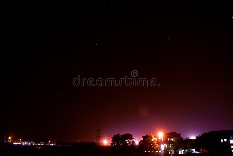 Nacht met citylight stock foto's