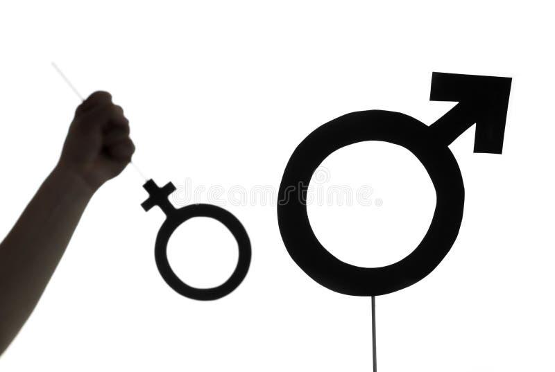Nacionalismo masculino, direitos da mulher e conceito da igualdade de gênero fotografia de stock