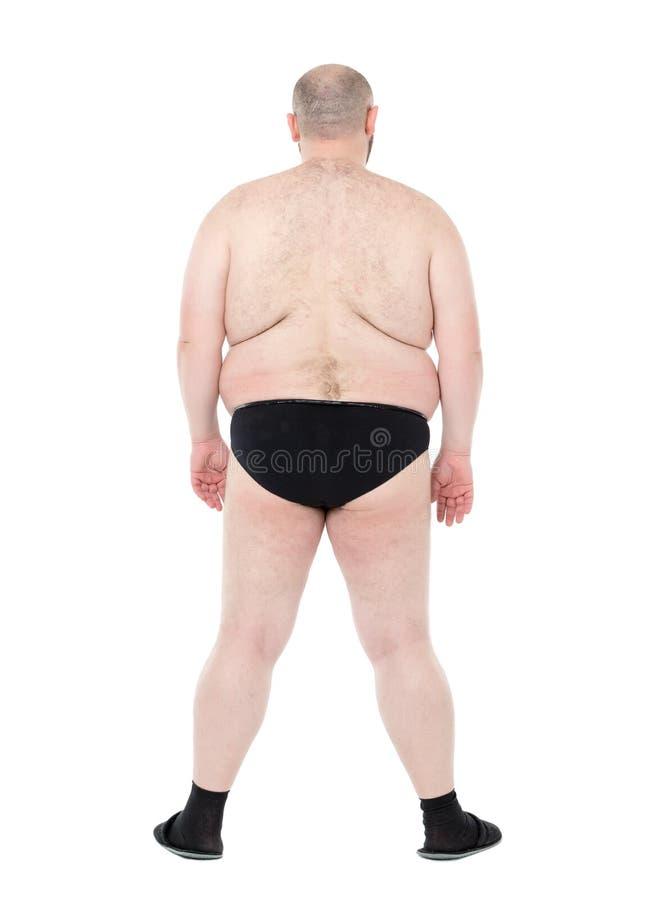 Nackter überladener Mann mit Rückseiten-Ansicht des dicken Bauchs lizenzfreies stockfoto