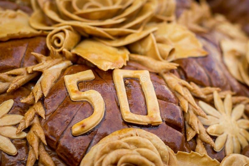 Naco, decorado com flores e um número 50 da massa, para fotografia de stock