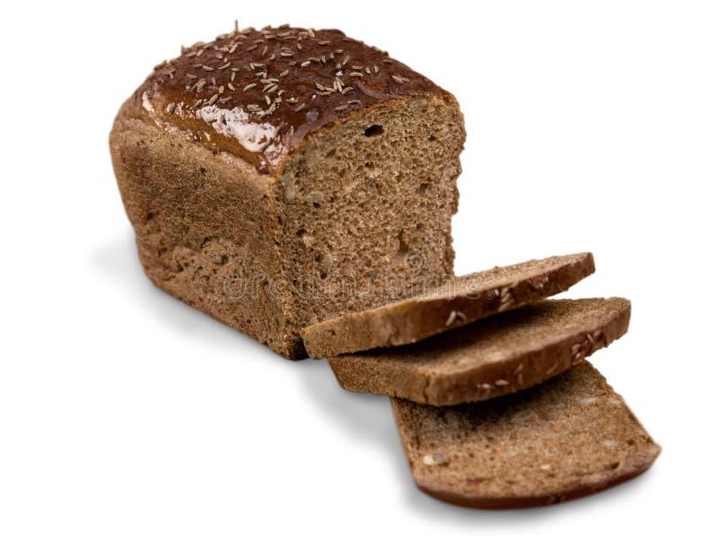 Naco do pão de mistura com as fatias isoladas no branco foto de stock royalty free