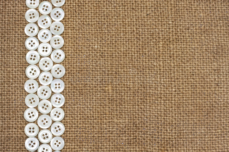 Nacre buttons on fabric texture vector illustration