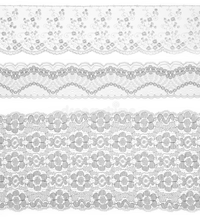 nad biały tasiemkowymi ustalonymi podstrzyżeniami tkaniny koronka fotografia royalty free
