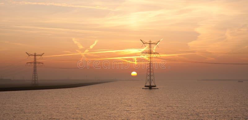 nad dennym wschód słońca holenderska elektryczność dwa fotografia stock
