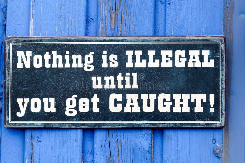 Nada es ilegal hasta que usted consiga la placa cogida foto de archivo libre de regalías