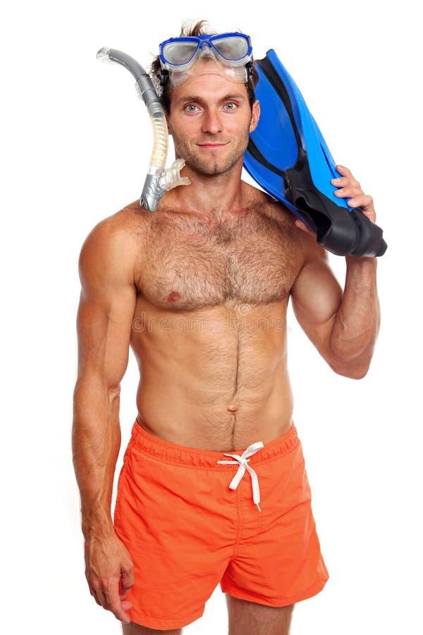 Nadador caucásico con la máscara, el tubo respirador y las aletas fotografía de archivo libre de regalías