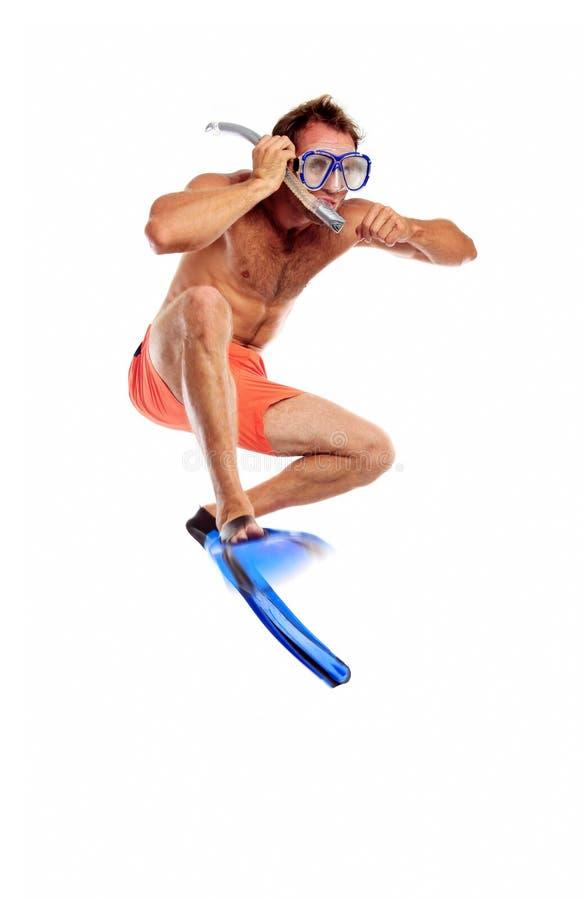 Nadador caucasiano na máscara, no snorkel e nas aletas fotografia de stock