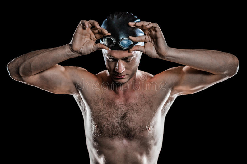 Nadador que guarda óculos de proteção da natação fotos de stock