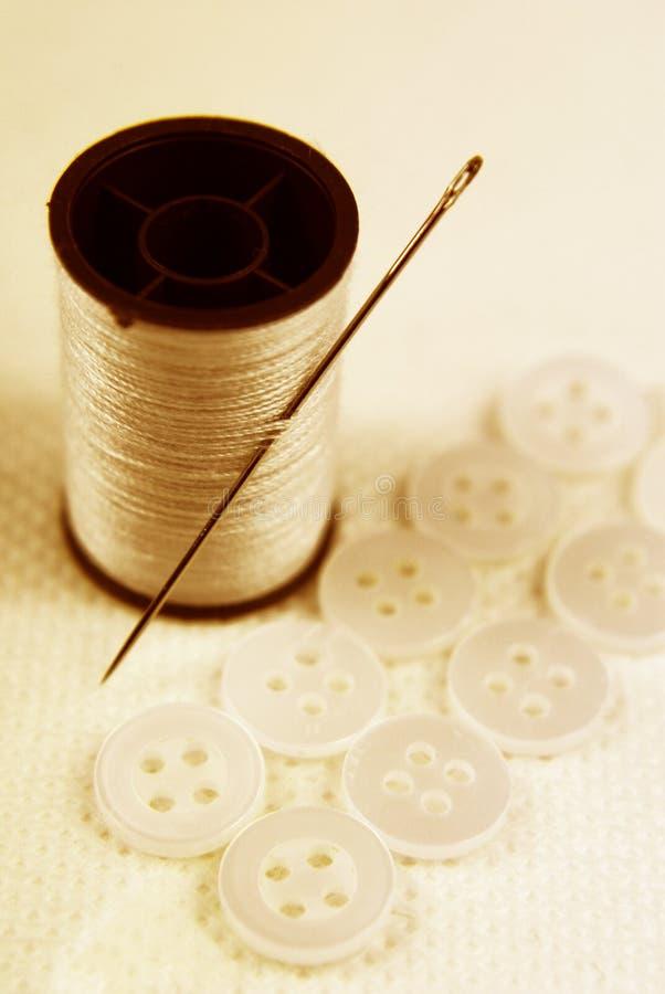Nadel und Baumwolle im Sepia lizenzfreies stockbild